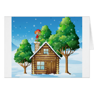 An elf with a gift standing above the house greeting card