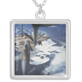 An F-15C Eagle aircraft sits behind a KC-135R Silver Plated Necklace