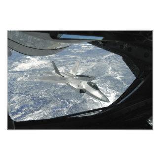 An F-22 Raptor banks away from a KC-135 Photo Print