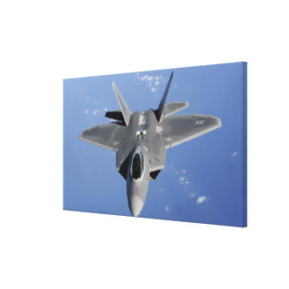 An F-22 Raptor moves into position to receive f Canvas Print