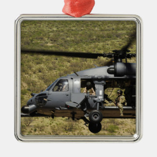 An HH-60 Pave Hawk flies over the desert Christmas Ornament