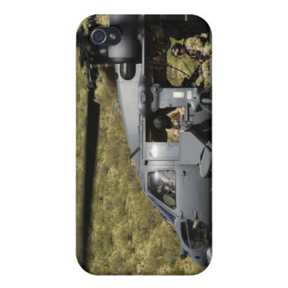 An HH-60 Pave Hawk flies over the desert iPhone 4/4S Covers
