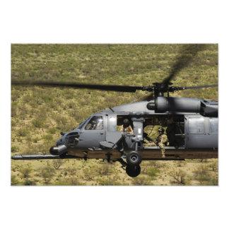An HH-60 Pave Hawk flies over the desert Photo Print