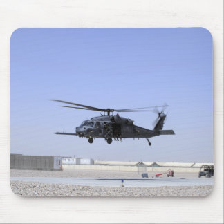 An HH-60G Pave Hawk taking off from Camp Bastio Mouse Pad