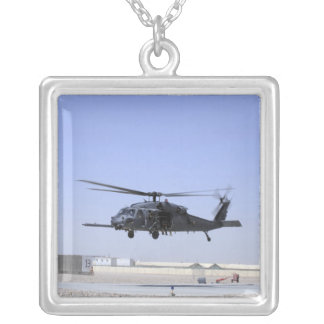 An HH-60G Pave Hawk taking off from Camp Bastio Silver Plated Necklace