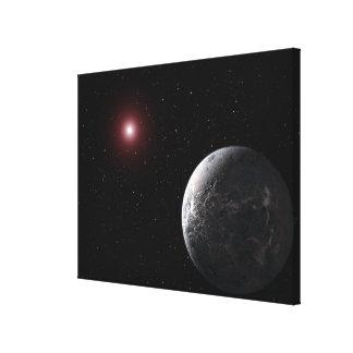 An icy/rocky planet orbiting a dim star canvas print