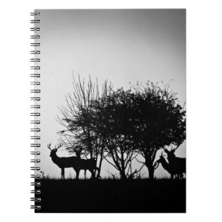 An image of some deer in the morning mist notebook