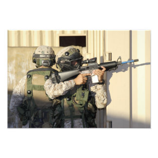 An infantry scout aims his weapon photo print