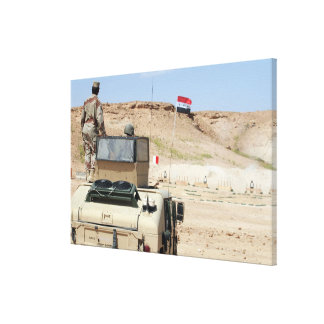 An instructor watches as an Iraqi army soldier Canvas Print
