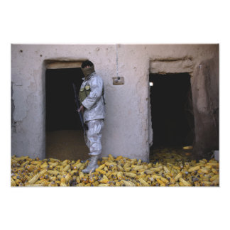 An Iraqi army soldier checks a storage room Photograph