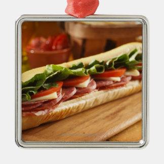 An Italian sub sandwich with 2 Christmas Ornament