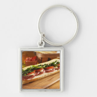 An Italian sub sandwich with 2 Key Ring