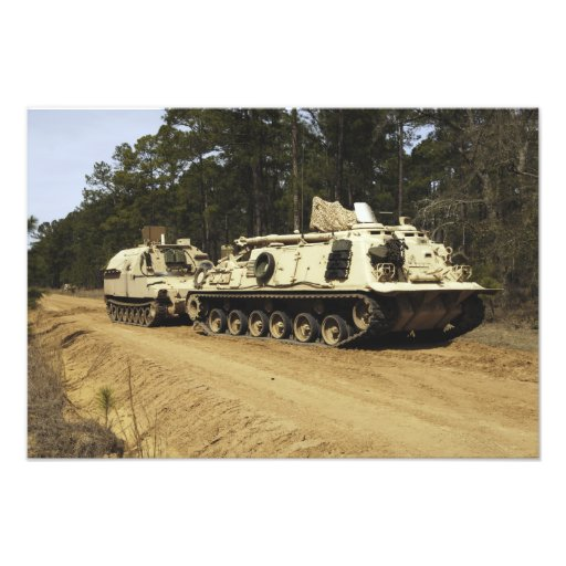 An M-88 recovery vehicle begins to tow an M992 Photograph