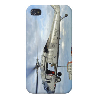 An MH-60S Seahawk prepares to deliver ammunitio iPhone 4 Cases
