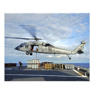 An MH-60S Seahawk prepares to deliver ammunitio Photo Print