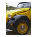 An old black and yellow Citroen 2CV 2 CV, Postcard
