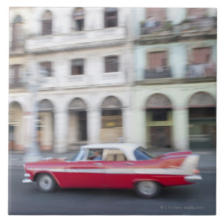 An old car cruising the streets of Havana, Cuba. Large Square Tile