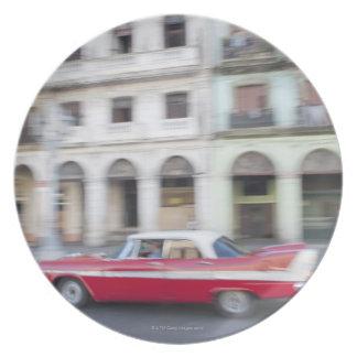 An old car cruising the streets of Havana, Cuba. Plate