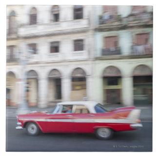 An old car cruising the streets of Havana, Cuba. Tile
