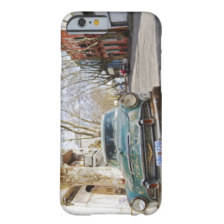 An old car rusty and flaky colour parked in the barely there iPhone 6 case