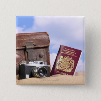 An old leather suitcase, retro camera and 15 cm square badge