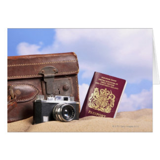 An old leather suitcase, retro camera and card