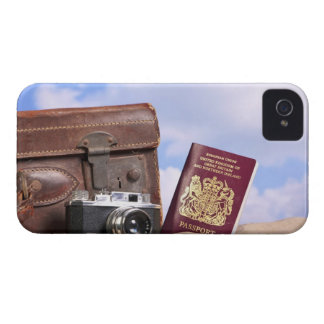 An old leather suitcase, retro camera and Case-Mate iPhone 4 case