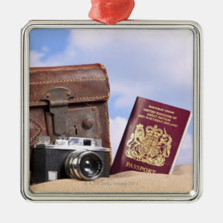 An old leather suitcase, retro camera and christmas ornament