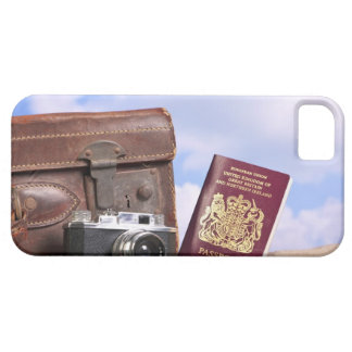 An old leather suitcase, retro camera and iPhone 5 covers