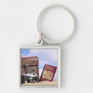 An old leather suitcase, retro camera and key ring