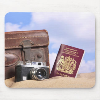 An old leather suitcase, retro camera and mouse mat