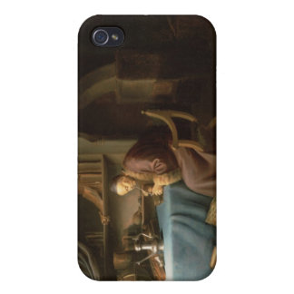 An Old Man Lighting his Pipe in a Study iPhone 4/4S Cases