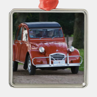 An old red Citroen 2CV car with a smiling woman Christmas Ornament