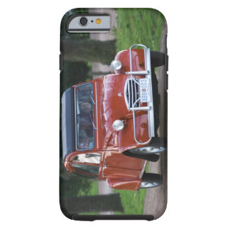 An old red Citroen 2CV car with a smiling woman Tough iPhone 6 Case