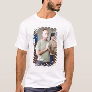 An older man in front of a younger woman T-Shirt