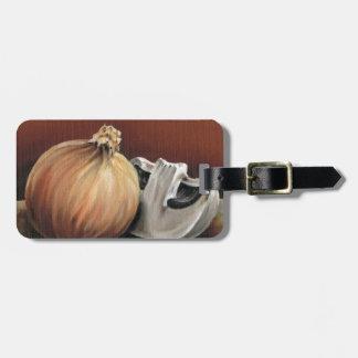 An onion and a mushroom luggage tag