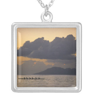 An outrigger canoe team practices off the coast silver plated necklace