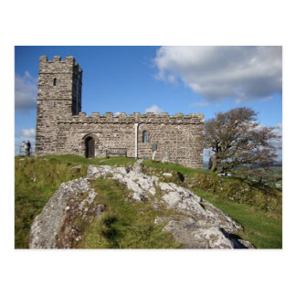 ancient stone church and windswept tree postcard