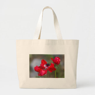 anemone coronaria in the garden large tote bag