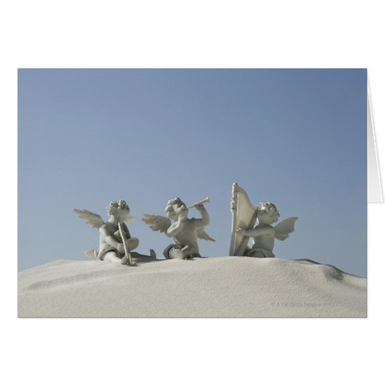 Angel figurines with musical instruments on card