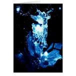 Angel in blue on black Christmas card
