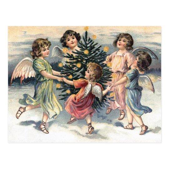 Angels dancing around the Christmas tree Postcard