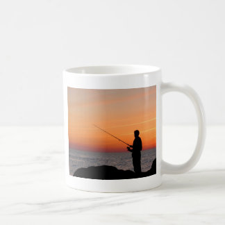 Angler and sunset on shore of the Baltic Sea Mugs
