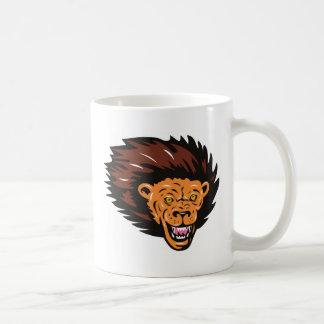 angry lion head attacking mug