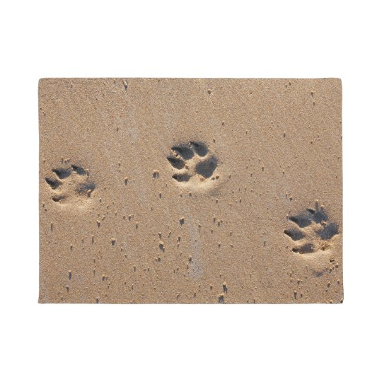 Animal paw prints in sand doormat