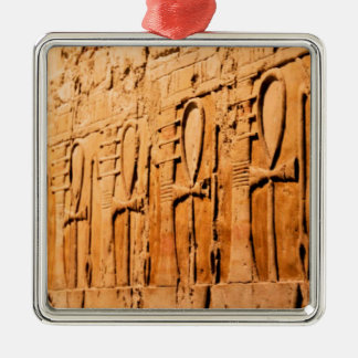 Ankh carvings.jpg Silver-Colored square decoration