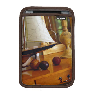 Antique Baseballs On A Table By A Model Sailboat iPad Mini Sleeve