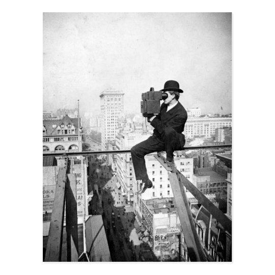 antique camera on a city highrise vintage photo postcard