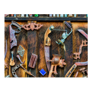 Antique collection on wall postcard