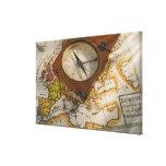 Antique compass on map canvas print